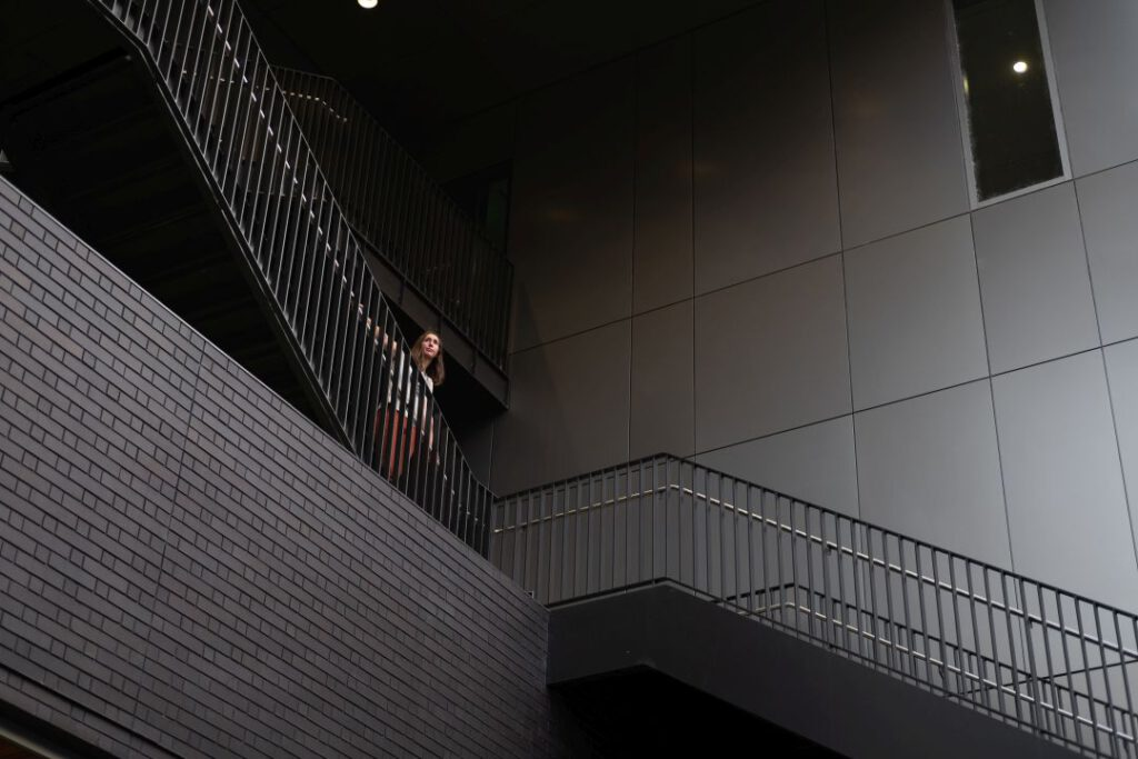 Person standing on white staircase